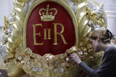 A City and Guilds student works on one of the decoration for the Diamond Jubilee Pageant Royal Barge at the London Art School in London