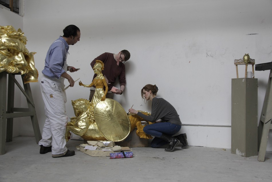 City and Guilds students work on one of the decoration for the Diamond Jubilee Pageant Royal Barge at the London Art School in London