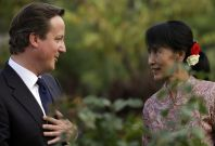 British PM Cameron chats with Nobel laureate and newly elected parliamentarian Aung San Suu Kyi at her residence in Yangon