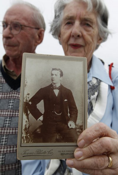 Patricia Watt holds a picture of her grandfather George Mackie while onboard the Titanic Memorial Cruise in the mid-Atlantic Ocean
