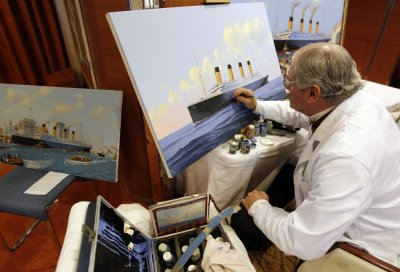 Maritime artist Flood of Florida paints the doomed Titanic liner as it would have appeared arriving in New York, onboard the Titanic Memorial Cruise in the mid-Atlantic Ocean