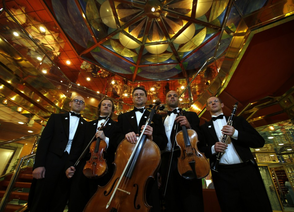 Members of the Belgian quintet ensemble Grupetto pose onboard the Titanic Memorial Cruise in the mid-Altantic Ocean
