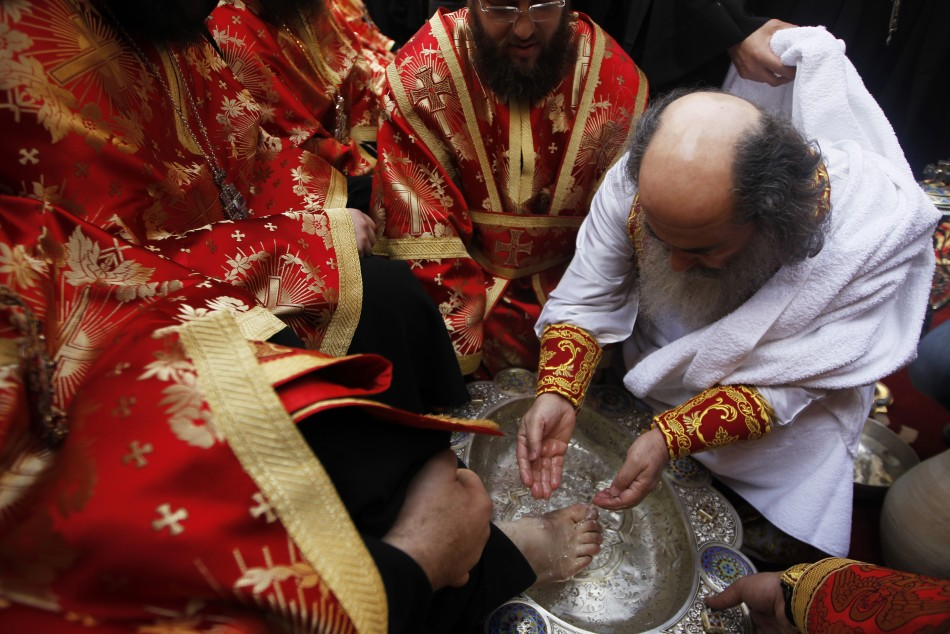 Greek Orthodox Patriarch of Jerusalem Theophilos washes the foot of a priest .