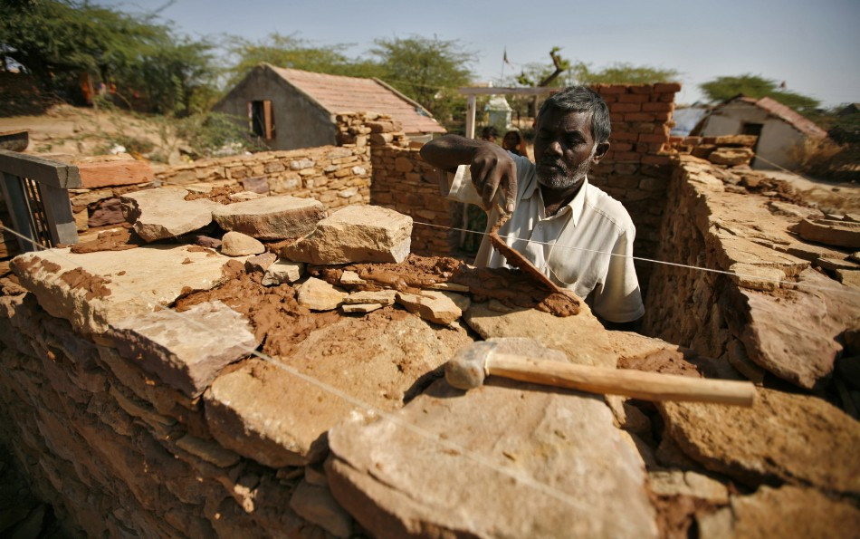 Bhai, an earthquake survivor, builds his house that was destroyed by the 2001 earthquake, at Rapar village in the western Indian state of Gujarat