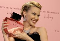 """Pop star Minogue poses with her new perfume """"Darling"""" in London"""