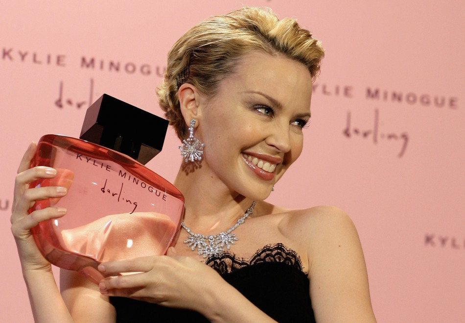 "Pop star Minogue poses with her new perfume ""Darling"" in London"