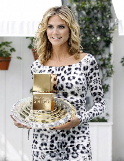 German model Heidi Klum poses during the launch of her new fragrance Shine in West Hollywood