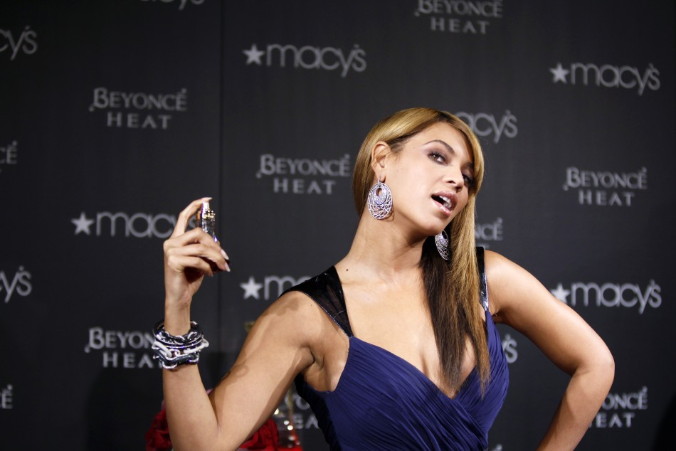 Singer Beyonce smiles as she makes an appearance at the Macys department store to promote her new fragrance Heat in New York