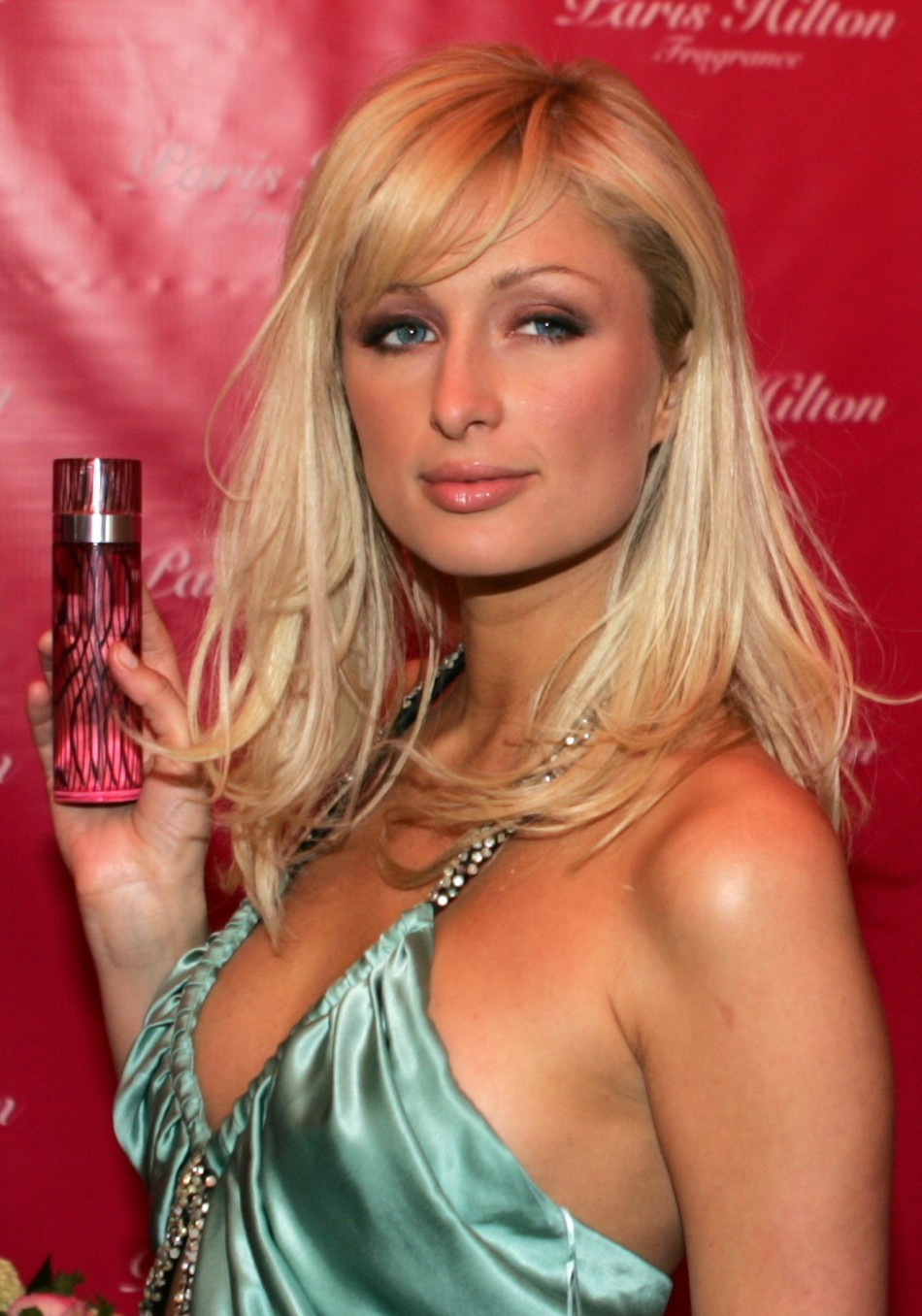 Reality TV star Hilton of the US poses with her new perfume outside a night club on the Champs ...