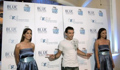 Spains actor Antonio Banderas gestures during the presentation of his new perfume at a Buenos Aires hotel