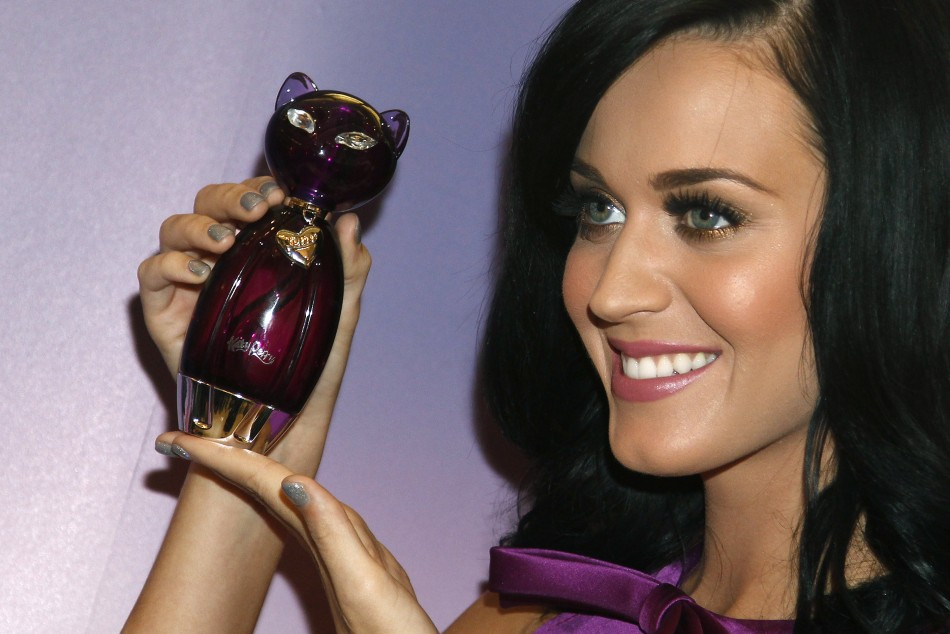 Singer Perry poses with her fragrance 'Purr' at Selfridges department store on Oxford Street in London