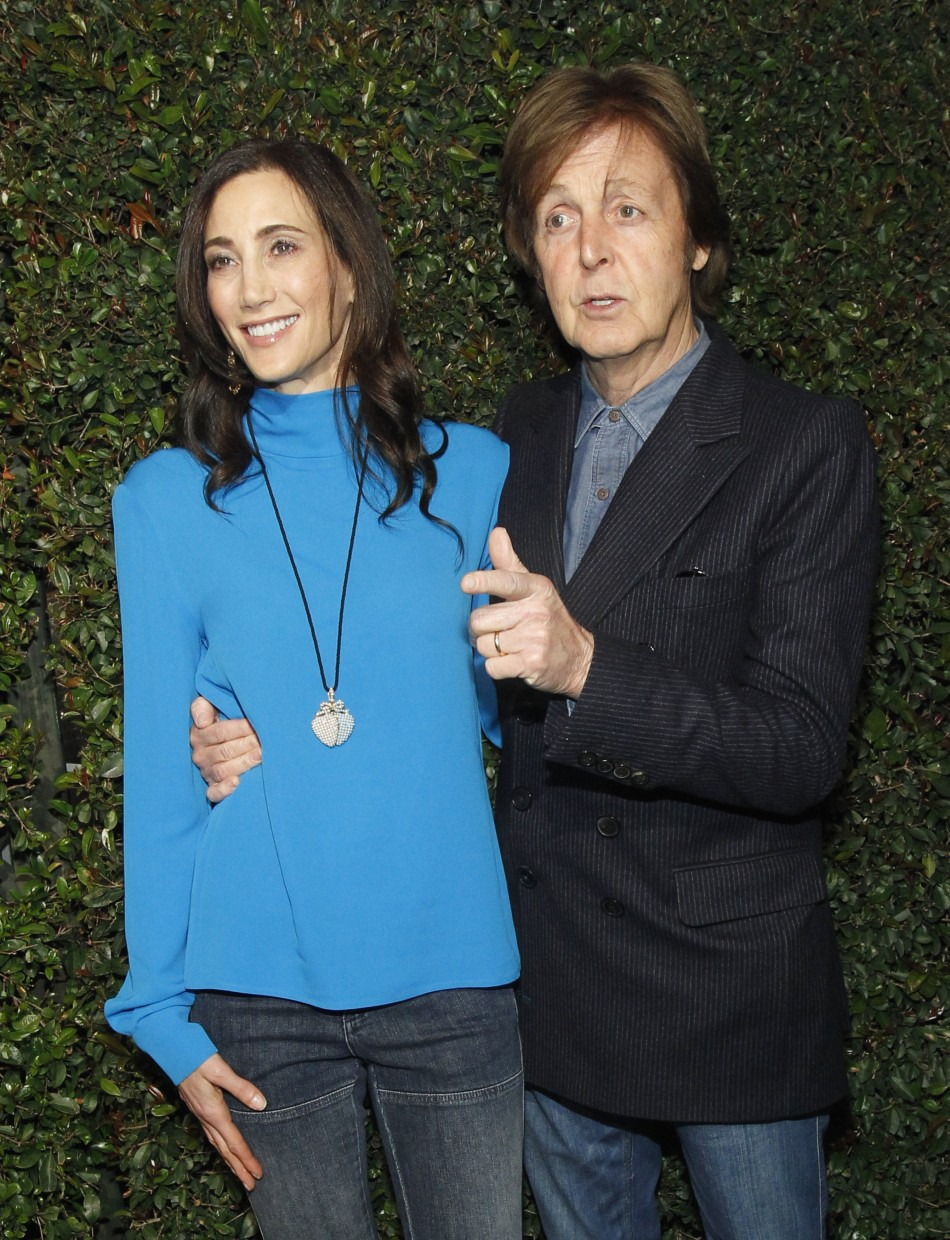 "McCartney and his wife Nancy Shevell pose as they arrive for the world premiere of the video ""My Valentine"" directed by Paul McCartney in West Hollywood"