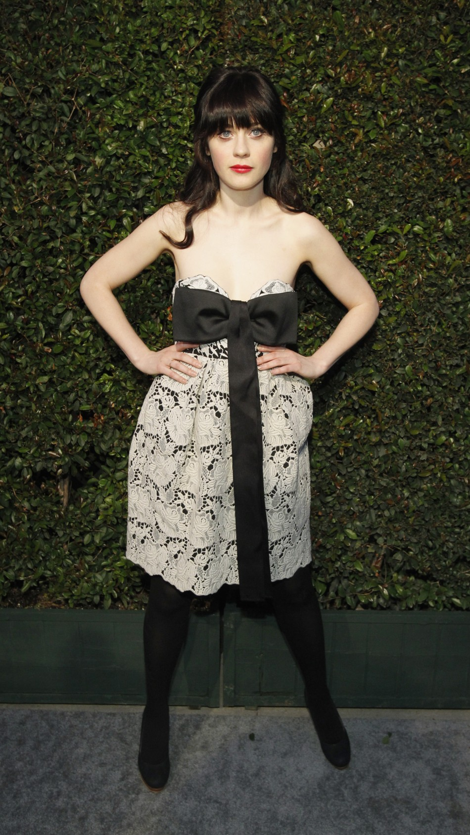 Deschanel poses as she arrives for the world premiere of the video quotMy Valentinequot directed by Paul McCartney in West Hollywood