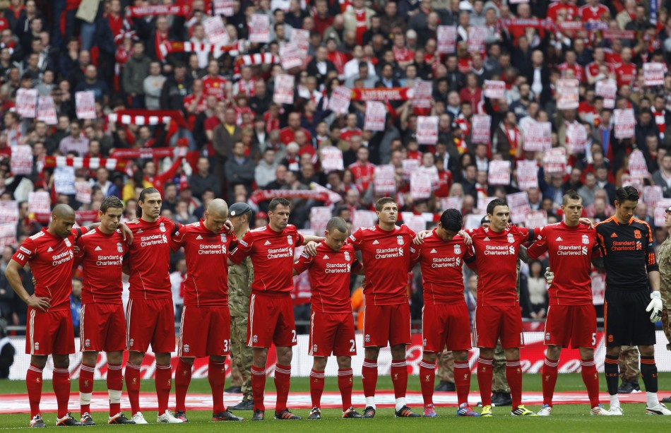 Liverpool039s players stand for a minute039s silence before their FA Cup semi-final soccer match against Everton in London