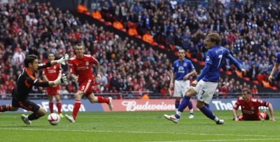 Everton039s Jelavic scores past Liverpool goalkeeper Jones during their English FA Cup semi-final soccer match in London