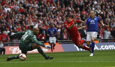 Liverpool039s Luis Suarez shoots and scores his goal against Everton during their English FA Cup semi-final soccer match at Wembley Stadium in London