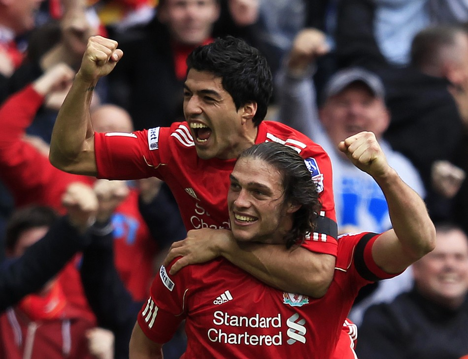 Liverpool039s Carroll celebrates his goal against Everton with teammate Suarez during their English FA Cup semi-final soccer match in London