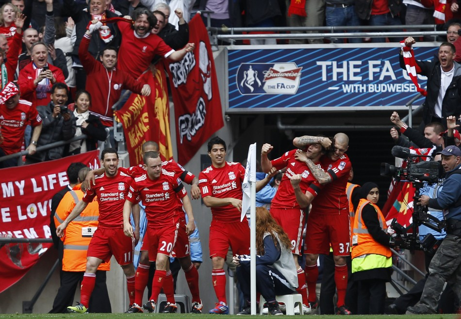 Liverpool039s Carroll celebrates his goal against Everton with teammates during their FA Cup semi-final soccer match in London