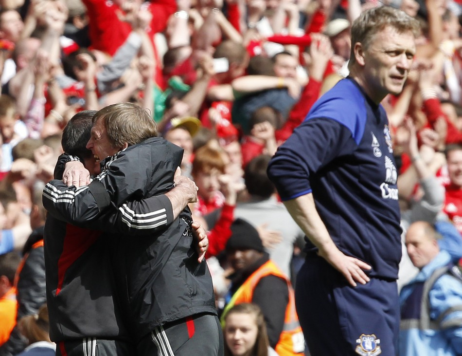 Liverpool039s manager Dalglish celebrates winning as his Everton counterpart Moyes reacts after their FA Cup semi-final soccer match in London