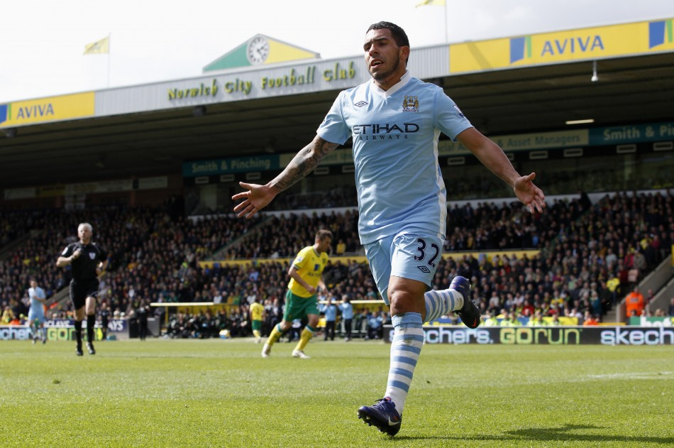 Carlos Tevez celebrates one of his three goals against Norwich.