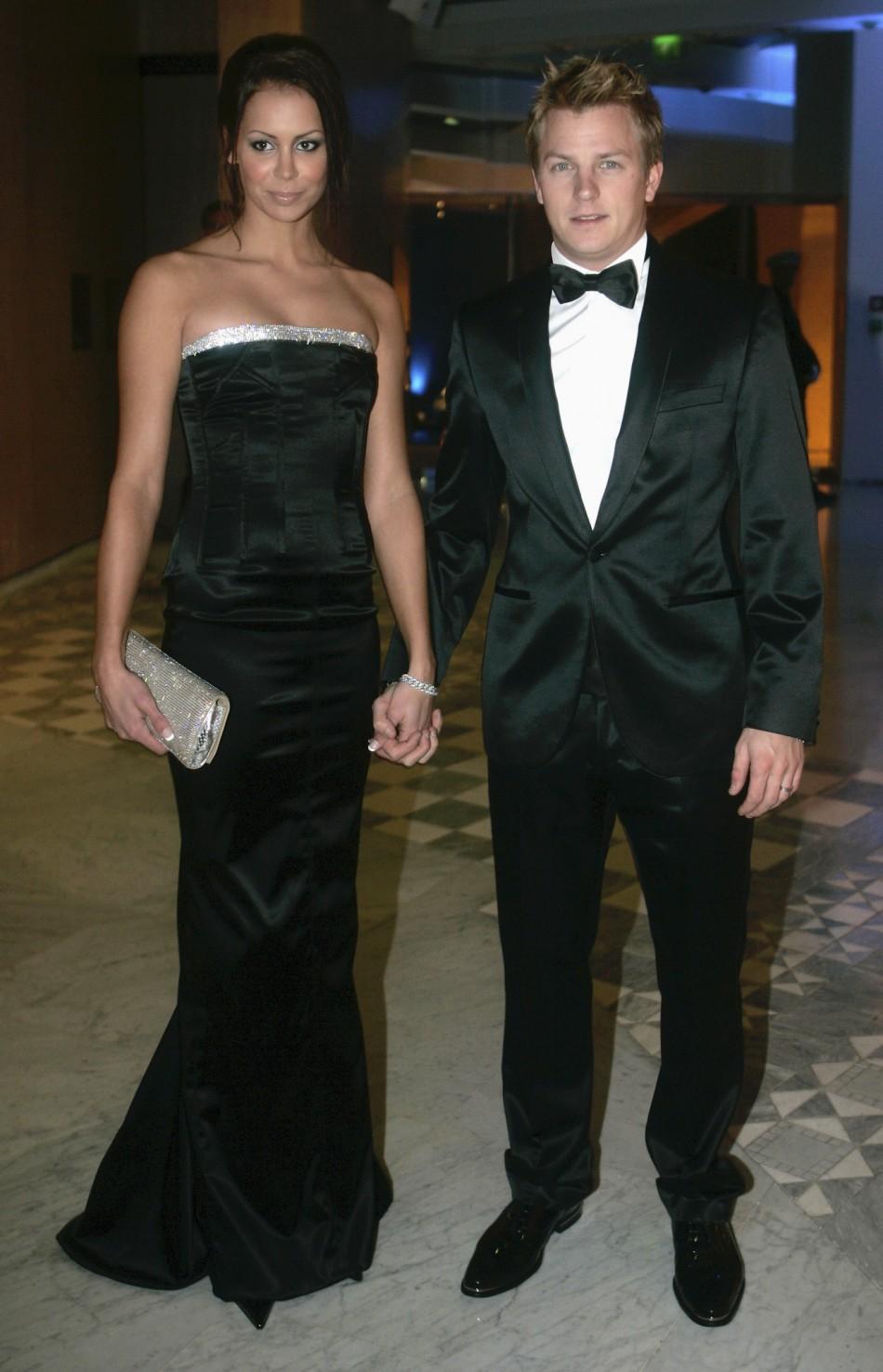 Formula One world champion Kimi Raikkonen and his wife Jenni Dahlman arrive at the 2007 FIA Prize Giving gala in Monaco