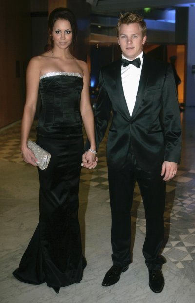 Formula One world champion Kimi Raikkonen and his wife Jenni Dahlman arrive at the 2007 FIA Prize Giving gala in Monaco