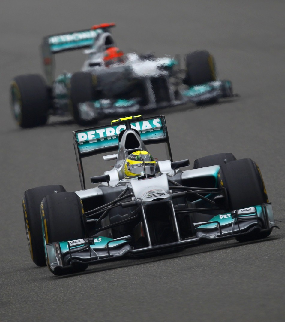 Mercedes' Nico Rosberg (in front) and Michael Schumacher