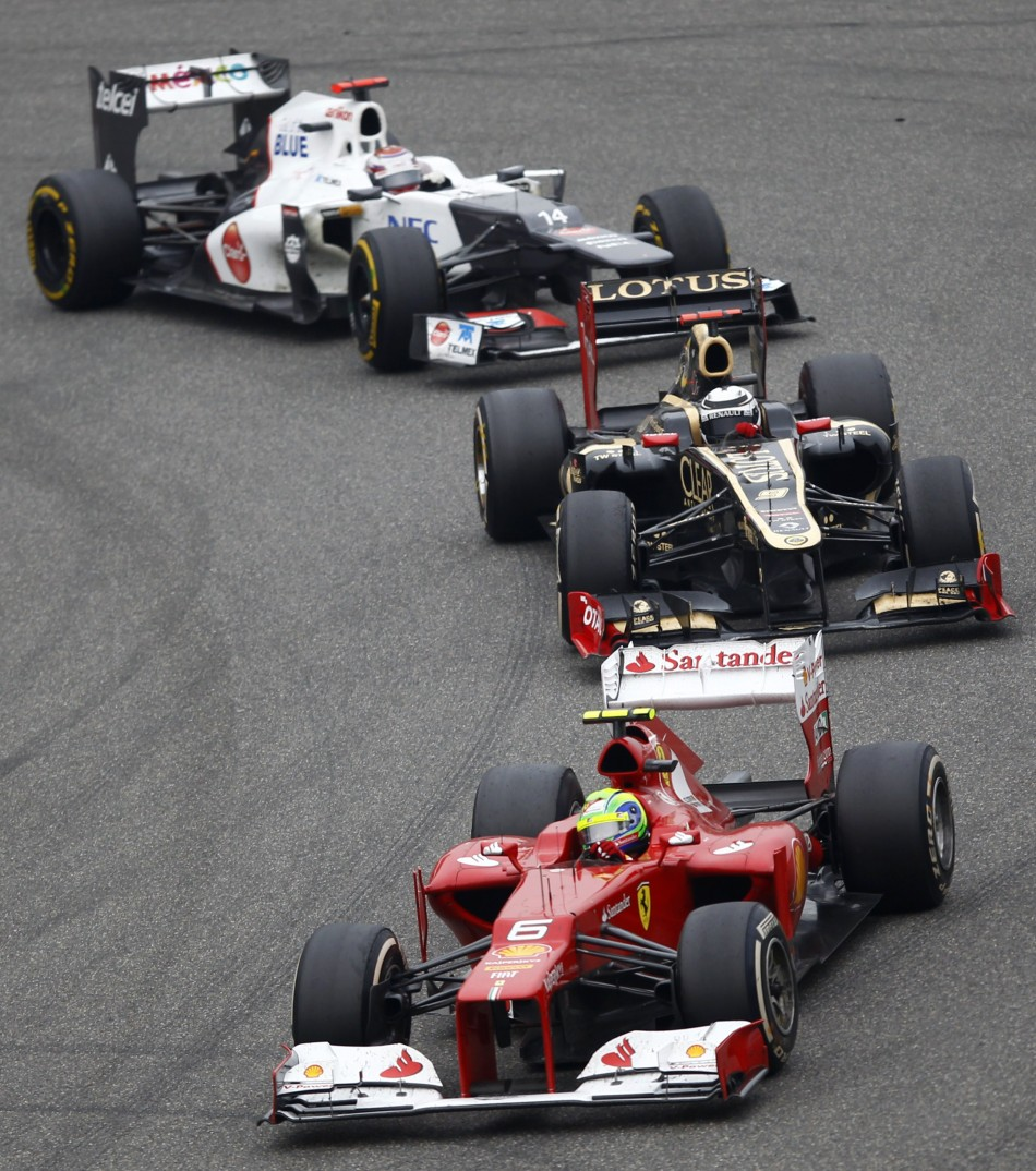 Ferrari Formula One driver Massa leads Lotus F1039s Raikkonen and Sauber039s Kobayashi during the Chinese F1 Grand Prix at Shanghai circuit