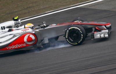 McLaren Formula One driver Hamilton brakes during the Chinese F1 Grand Prix at Shanghai circuit