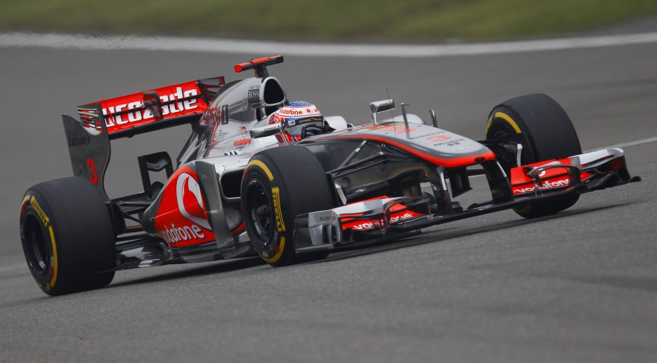McLaren Formula One driver Button drives during the Chinese F1 Grand Prix at Shanghai circuit