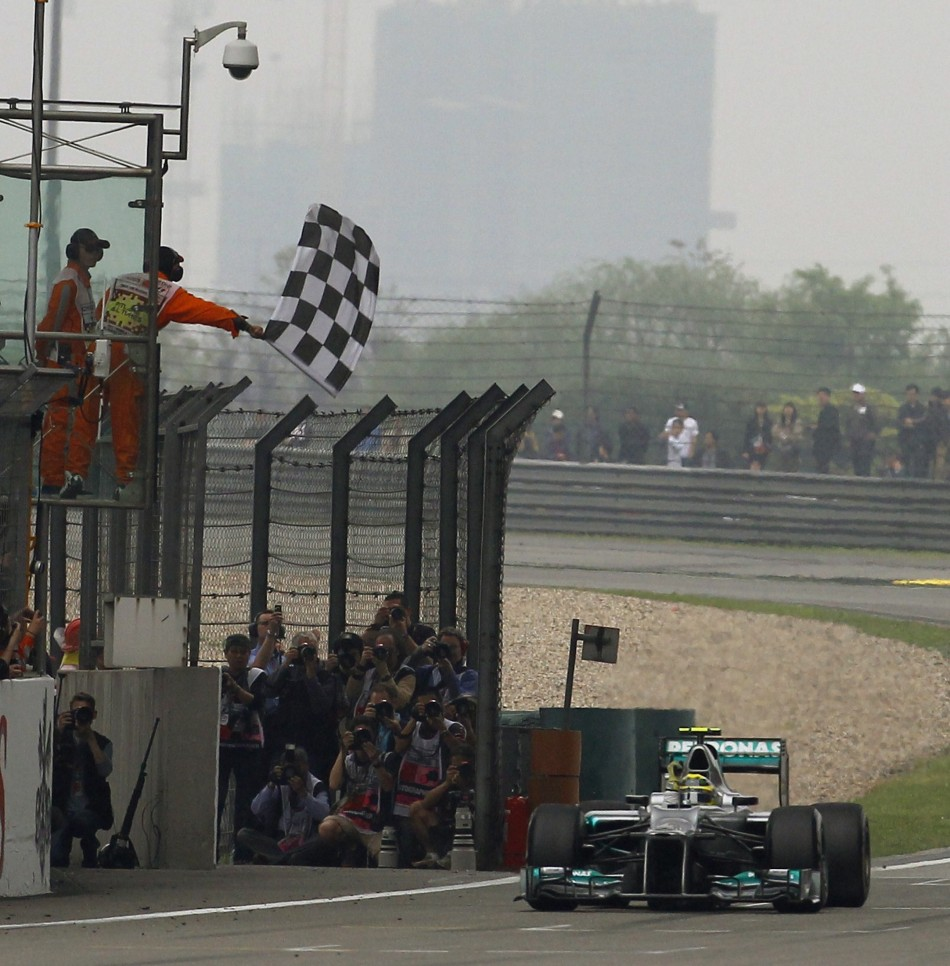 Mercedes Formula One driver Rosberg takes the chequered flag to win the Chinese F1 Grand Prix at Shanghai circuit