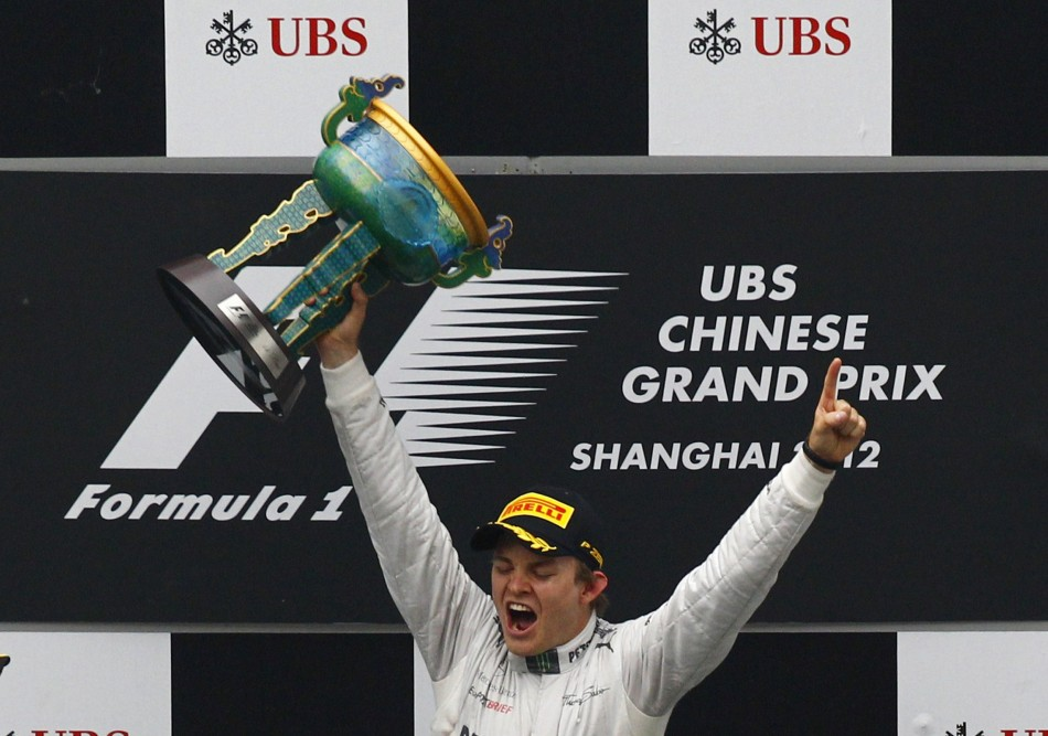 Mercedes Formula One driver Rosberg celebrates on the podium winning the Chinese F1 Grand Prix at Shanghai circuit