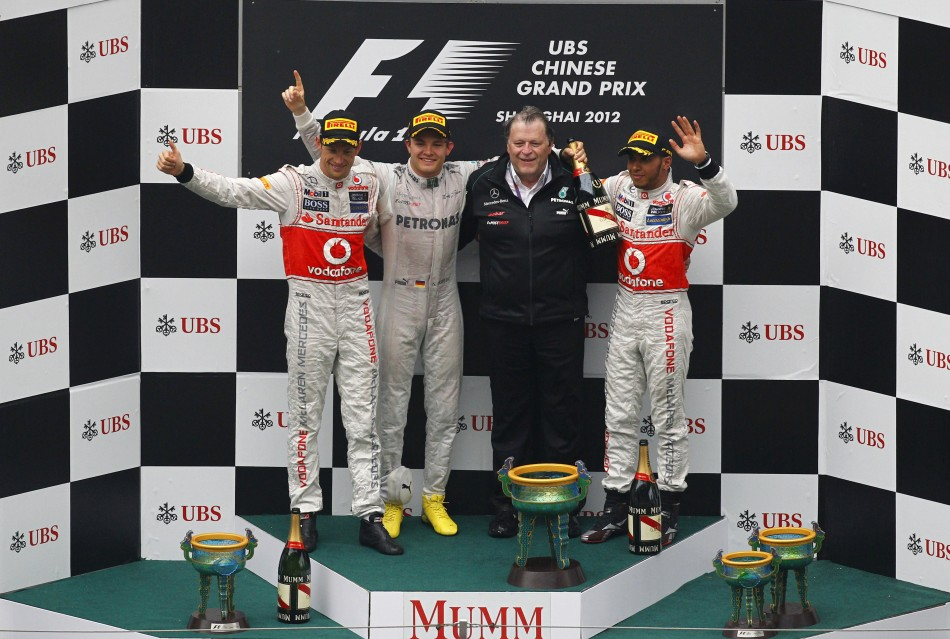 McLaren Formula One driver Button, Mercedes039 Rosberg, Mercedes chief Haug and McLaren039s driver Hamilton celebrate on the podium the Chinese F1 Grand Prix at Shanghai circuit