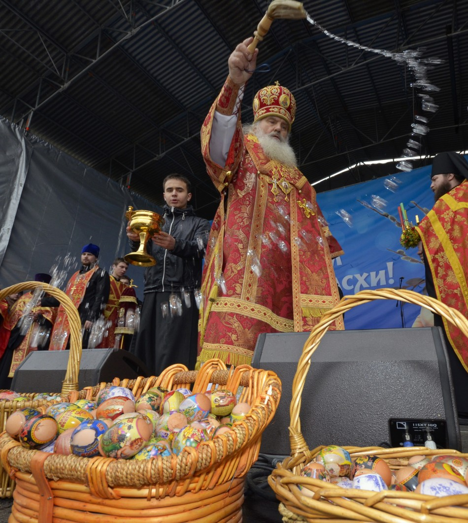 An Orthodox priest blesses Easter eggs after a religious service in Russia's far Eastern port of Vladivostok