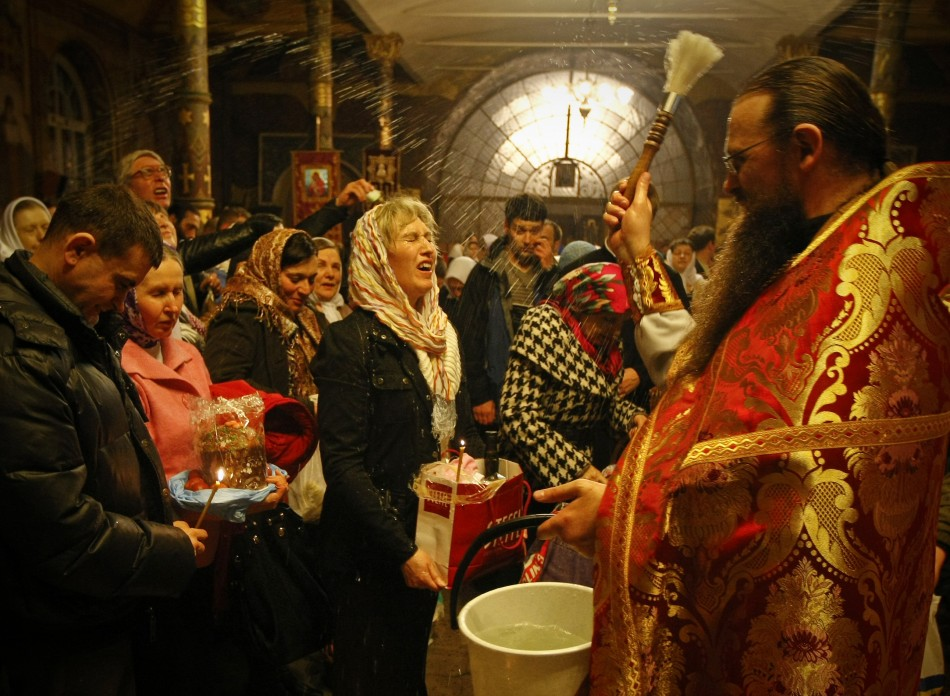 A priest blesses worshipers during an Orthodox Easter service at Kievo-Pecherskaya Lavra cathedral in Kiev