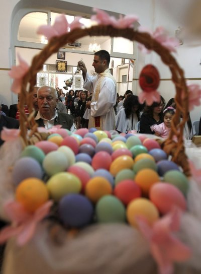 Iraqi Christians attend an Easter mass at Chaldean Catholic church in Amman
