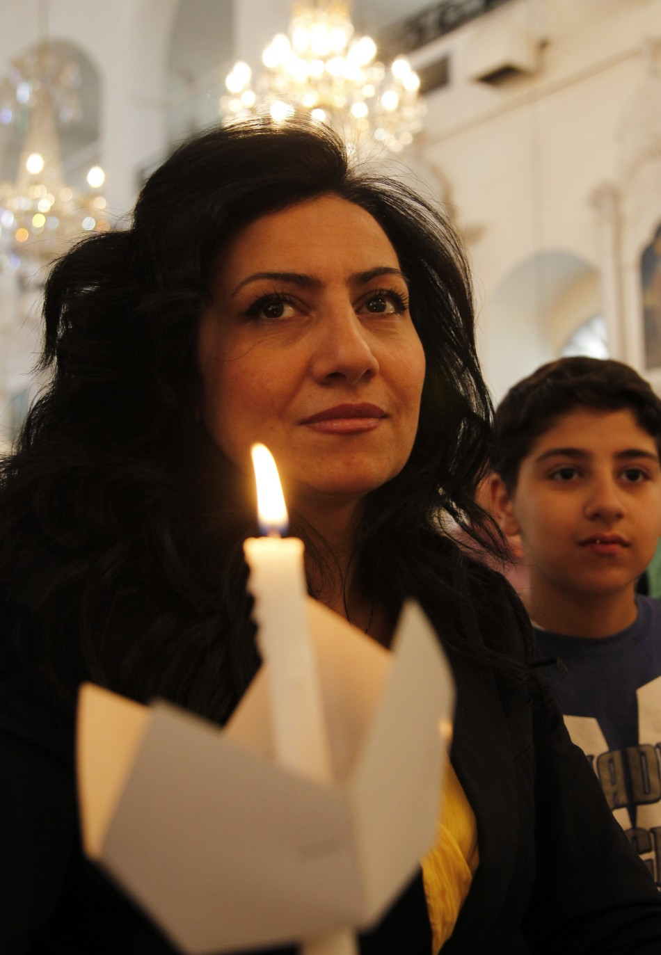 A Syrian woman attends a mass of an Orthodox Easter at the Roman Orthodox patriarchate in Damascus