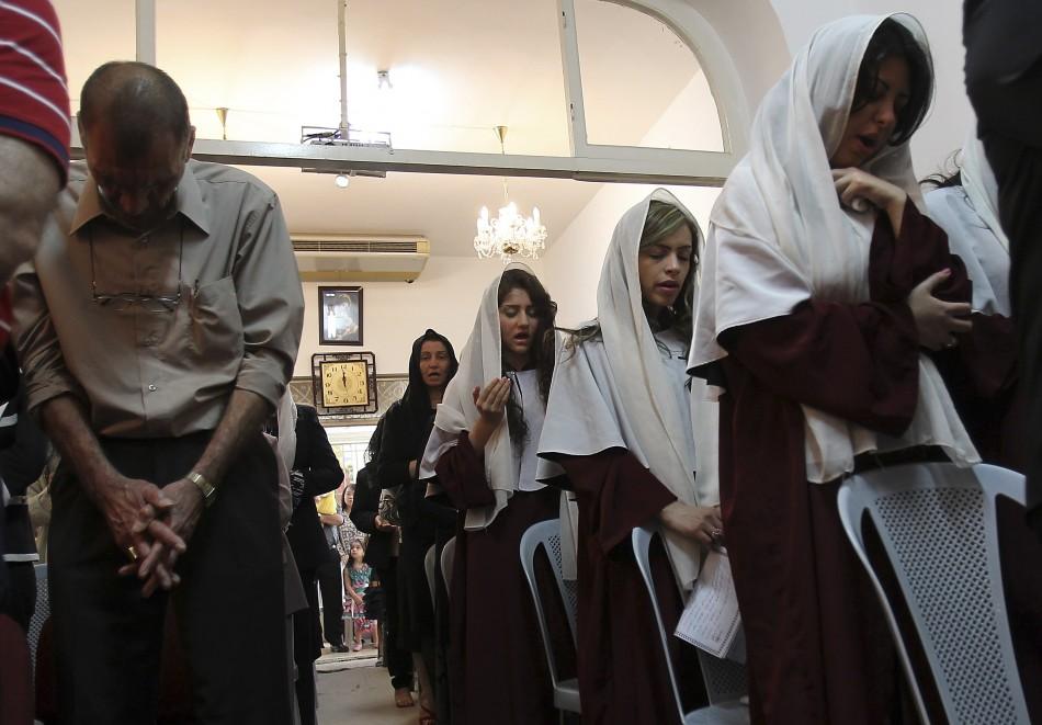 Iraqi Christians attend an Easter mass at Chaldean Catholic church in Amman