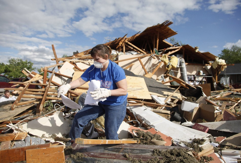 Trish Ford, of Woodward, Oklahoma, looks for personal papers for a friend whose office was destroyed by a tornado