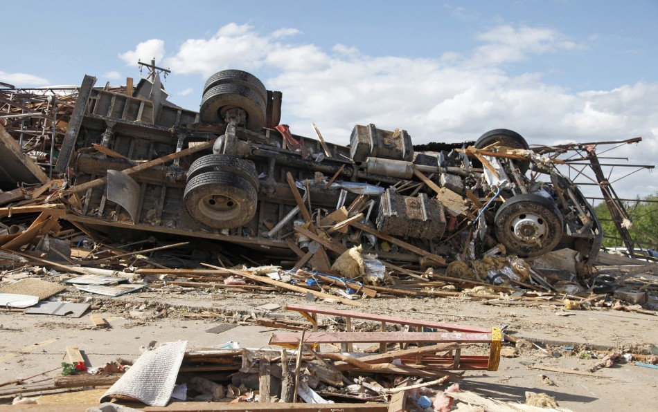A truck lies on its side after a tornado struck Woodward