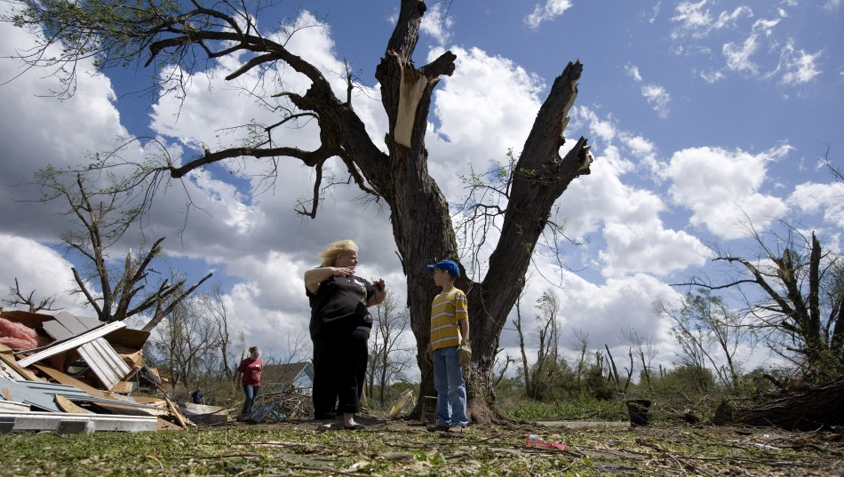 A woman describes her experience after she survived a tornado, to her relative in Thurman, Iowa