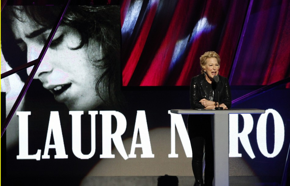 Bette Midler speaks as singer Laura Nyro is posthumously inducted into the 2012 Rock n' Roll Hall of Fame in Cleveland, Ohio