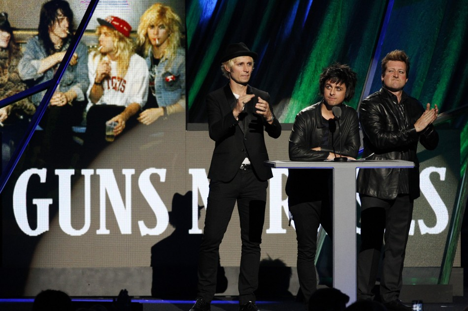 Members of Green Day introduce the band Guns N' Roses as they are inducted into the Rock n' Roll Hall of Fame in Cleveland, Ohio