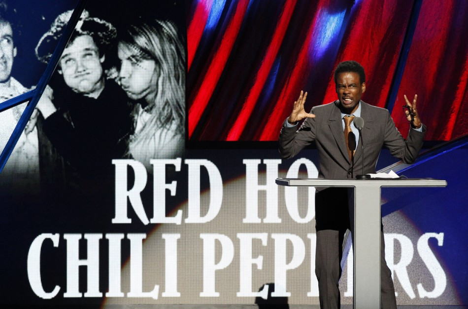 Comedian Chris Rock introduces the Red Hot Chili Peppers during the 2012 Rock n' Roll Hall of Fame induction ceremony in Cleveland, Ohio