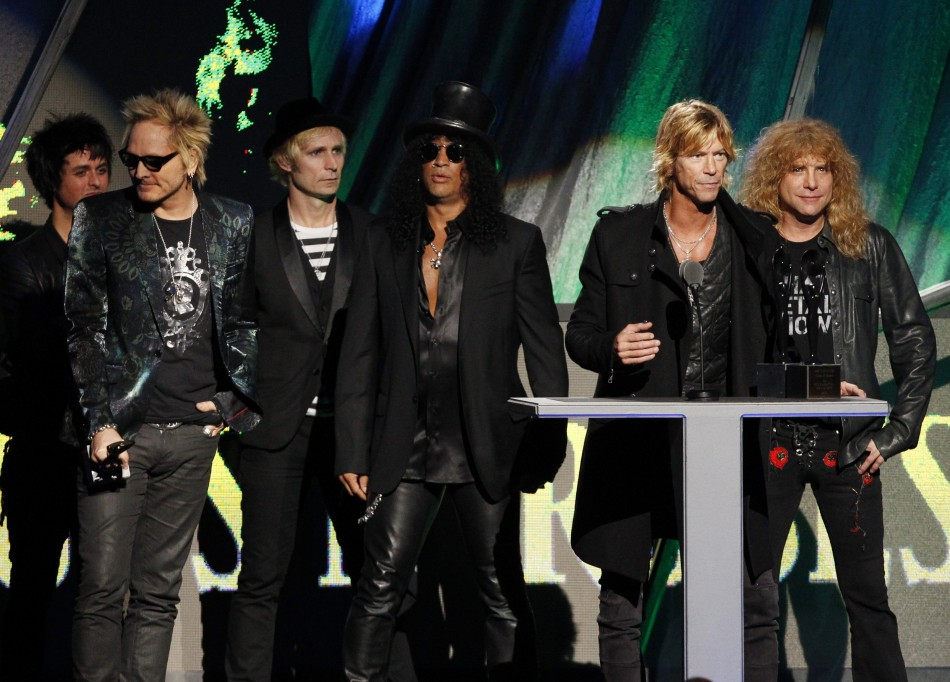Members of the band Guns N' Roses speak after their induction into the Rock n' Roll Hall of Fame in Cleveland, Ohio
