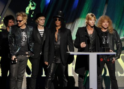 Members of the band Guns N Roses speak after their induction into the Rock n Roll Hall of Fame in Cleveland, Ohio