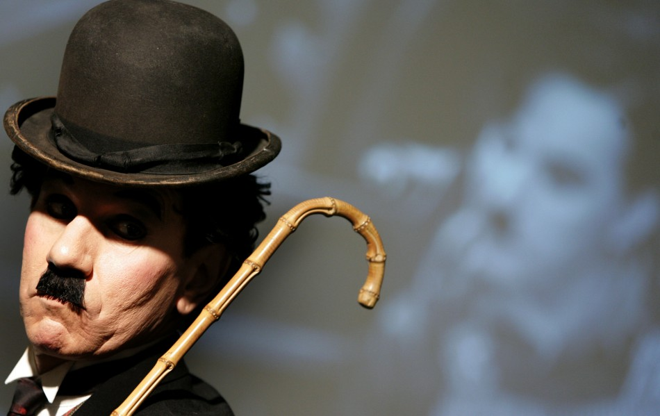 Charlie Chaplin impersonator Tobias Santiago wears the bowler hat and cane used by Charlie Chaplin