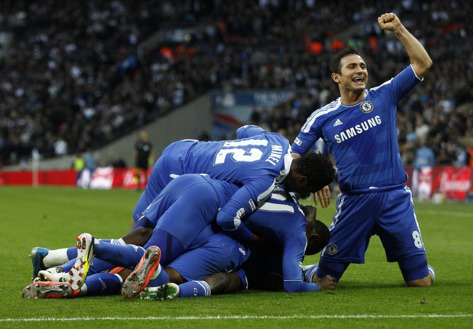 Frank Lampard celebrates as his teammates jump on Ramires after he scored during their FA Cup semi-final match against Tottenham Hotspur (Reuters)
