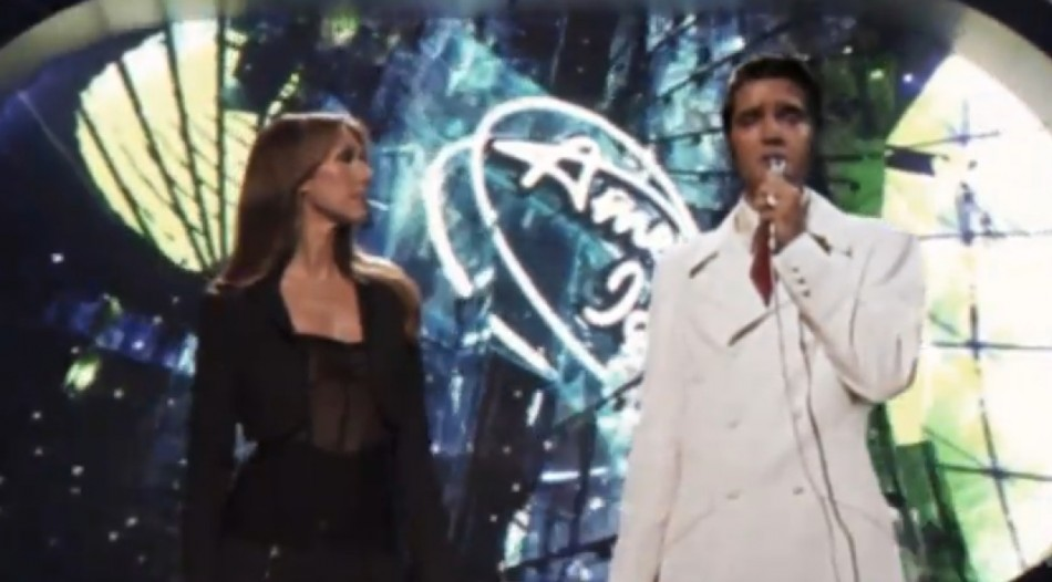Singers Celine Dion and holographic Elvis Presley perform duet of King of rock n rolls hit single If I Can Dream during guest spot on 2007 edition of American Idol