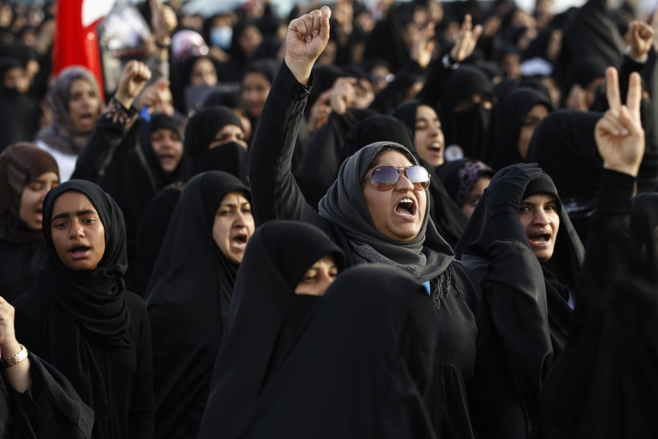 Protesters march in the village of Salmabad, south of Manama